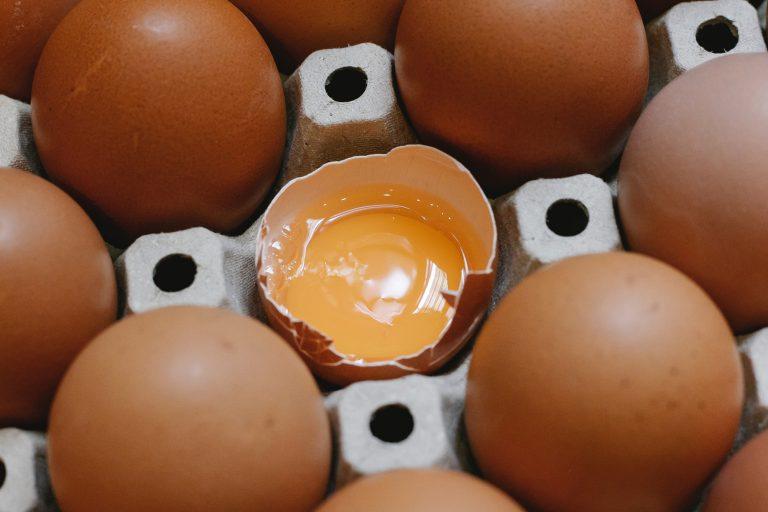 Half Open Egg Inside an Egg Tray
